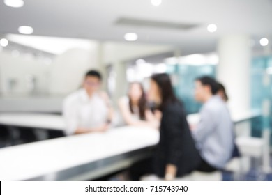 Blurred soft of people meeting at table