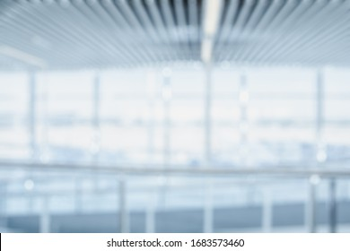 BLURRED SPACIOUS OFFICE BACKGROUND, MODERN BLUE BUSINESS HALL, LIGHT COMMERCIAL OPEN SPACE WITH BIG WHITE GLASSY WINDOWS, DEFOCUSED HALLWAY
