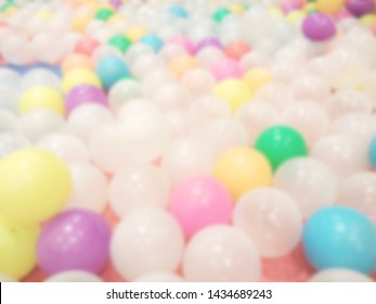 Blurred stack of variety color of balloon on floor for party, abstract soft color background