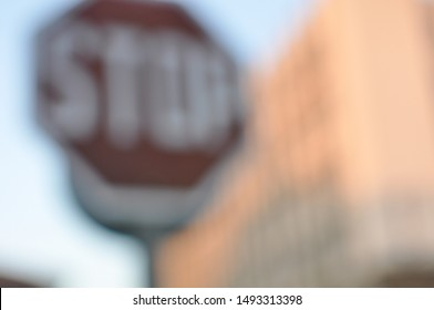 Blurred stop sign background in a city