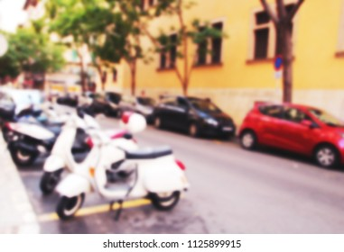 Blurred street background with vintage motorcycles and cars, Palma de Mallorca, Spain