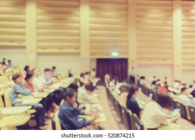 blurred student sitting for listening seminar or meeting about business program in convention hall background.