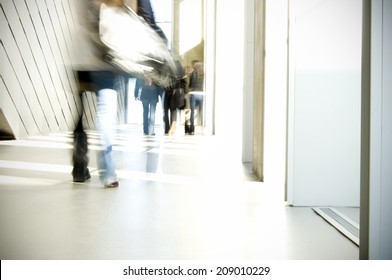 Blurred students walking in school hallway