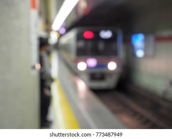 Blurred sub way train arriving at  station.