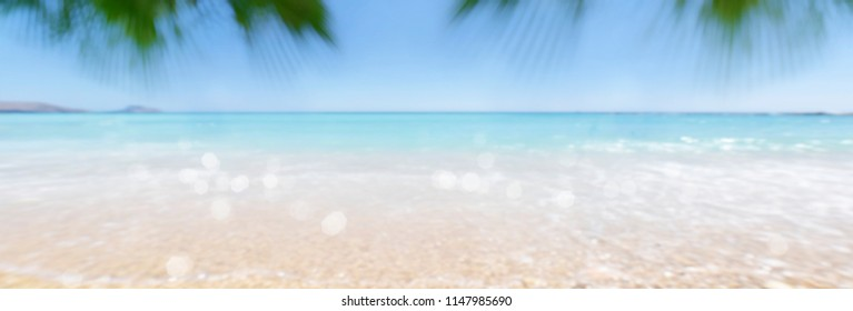 Blurred summer background with lighting bokeh on the sea