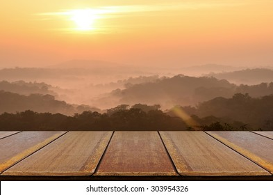 Blurred Sunrise Background and Mountain Landscapewith with Perspective Wood Window View.