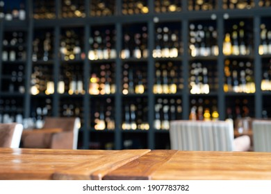Blurred table with the bar background behind