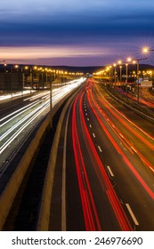Blurred tail tights and traffic tights on motorway with a long exposure photograph at night