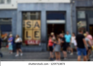 Blurred of tourist walking on sidewalk and enjoy shopping in street center in Maastricht. Maastricht is one of the famous shopping center in Netherlands. Travel style and street view concept.
