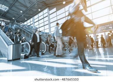 Blurred trade fair business visitors