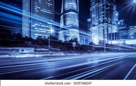blurred traffic light trails on road at night in China