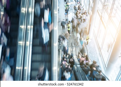 blurred traid fair visitors at a escalator, germany