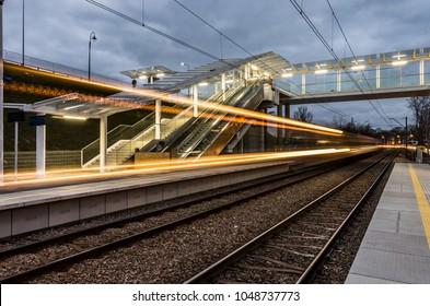 Blurred train lights on railway station, Krakow, Poland