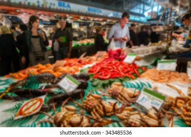 Blurred travel backgrounds - inside famous La Boqueria market with seafood in Barcelona, Spain. One of the oldest markets in Europe that still exist
