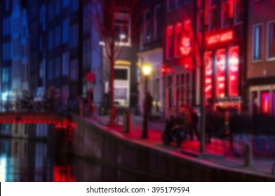 Blurred travel backgrounds - Night view of Red - light district in amsterdam, Netherlands, where is a concentration of sex shops, strip clubs, adult theaters, etc. Facade of Theater