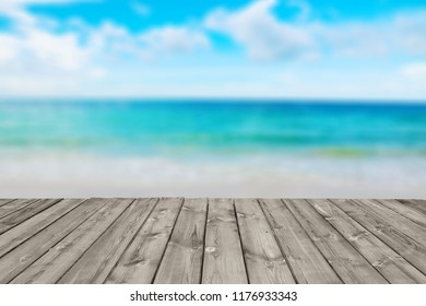 blurred tropical beach with sea sky and sunlight