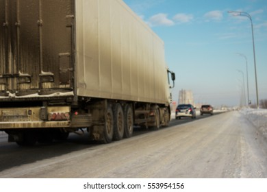 Blurred the truck on road. Container on the big winter highway. transport loads.