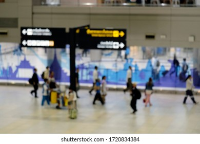 Blurred and unrecognizable people walking in the airport