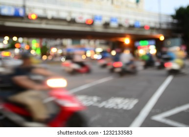 Blurred urban abstract traffic background. Motorcycle passing.