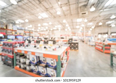 Blurred variety of modern digital DSLR on display at camera department in big-box store. Defocused background of distribution warehouse or storehouse, wholesale bokeh light. Business inventory concept
