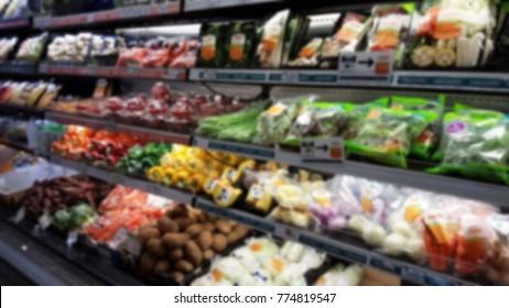 Blurred vegetables shelf, Supermarket Background. Blurred organic shelf background.