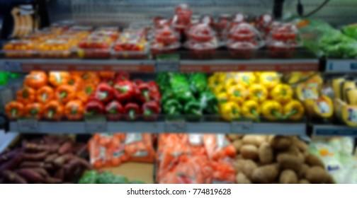 Blurred vegetables shelf, Supermarket Background. Blurred organic shelf background. Front organic shelf.