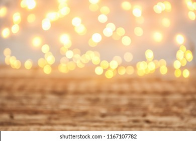 Blurred view of glowing Christmas lights, closeup