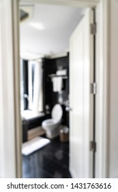Blurred view of hotel black and white restroom design
