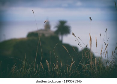 Blurred View Of The Lighthouse Of Candas