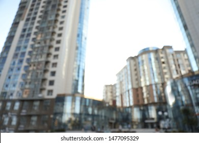 Blurred view of modern buildings with windows. Urban architecture
