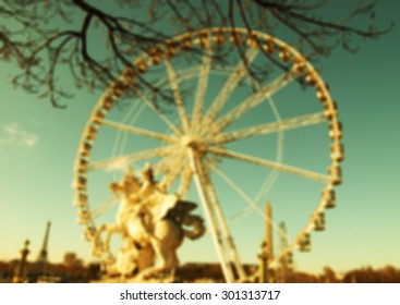 Blurred view on Place de la Concorde in Paris. Horseman statue, ferris wheel and Eiffel tower at background. Blurred retro aged darken photo.