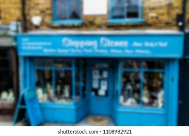 Blurred view of small business or shop at one of old London streets