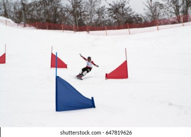 Blurred view of snowboarding giant slalom competitions. Use as background.