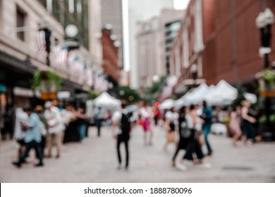 Blurred view of streets and buildings of Downtown Crossing, a pedestrian shopping zone in downtown Boston