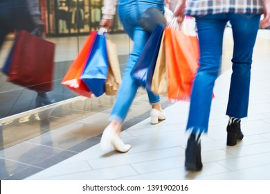 Blurred view of women during big shopping