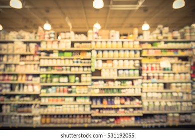 Blurred vitamin store shelves huge variation of organic whey protein, vitamins and remedies. Sport bodybuilding supplements nutrition, functional food. Fitness and healthy lifestyle. Vintage filter