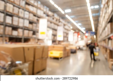 Blurred warehouse or storehouse background with some people