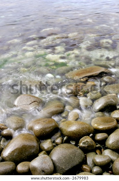 Blurred waves rolling onto rocks