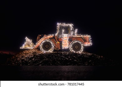 Blurred wheel loader decorated with lights