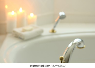 A blurred white background romantic bath with candles.