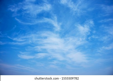 Blurred white clouds on the sky background.