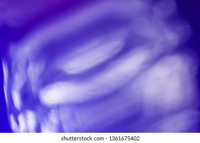 blurred white reflections over blue, abstract background