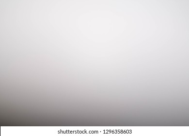 Blurred white wall ambient background.