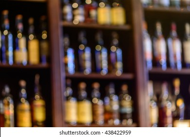 Blurred of wine bottles. Blurred image of bottles of wine on the shelves in market.