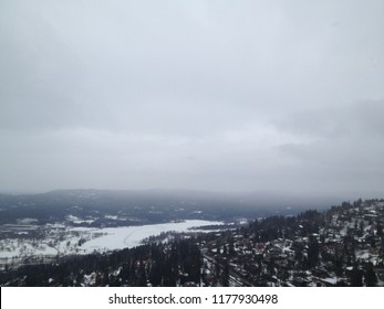 Blurred Winter view on Oslo on a cloudy day from Holmenkollen - Norway