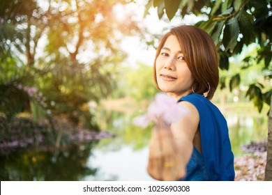 blurred of woman feeling happy in flower garden. subject is blurred.
