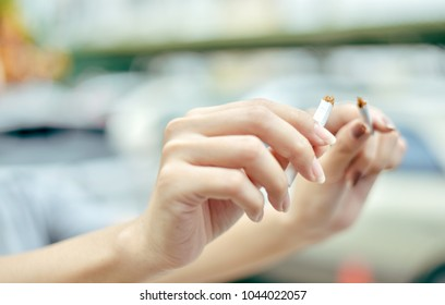 Blurred of Woman Hands. She happy to breaking a cigarette on blurred background.Quit smoking for life on World no Tobacco day concept.