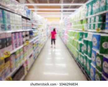 Blurred woman shopping in supermaket