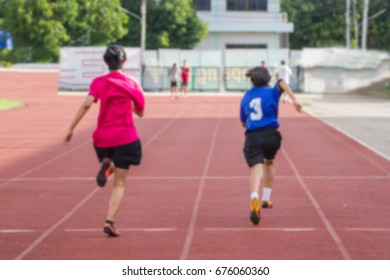 Blurred - Women athletes Runners to practice running at the stadium