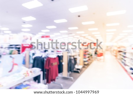 d55f1e440 Blurred women and kids clothing department at discount store retailer in USA.  Low prices fashion